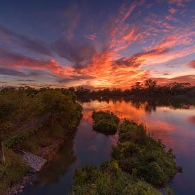by Gordon Koh - Landscapes Sunsets & Sunrises ( rock, reflection, nature, sunset, peace, punggol, clouds, quiet, lake, colors, colours )