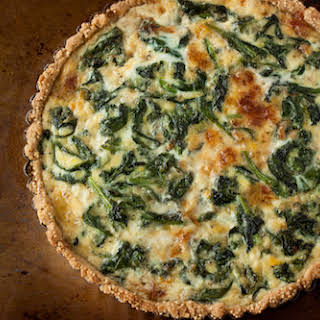 Caramelized Onion, Spinach, and Gruyere Tart with a Cornmeal-Millet Crust.