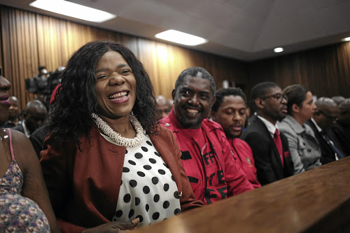 VINDICATED Former public protector Thuli Madonsela with the EFF's Godrich Gardee and Mbuyiseni Ndlozi in the North Gauteng High Court yesterday. Picture: Alaister Russell