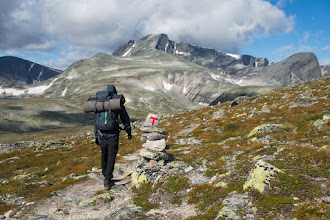 """Photo: In the valley between Snøhetta and Svånåtindene, on our way to ascend Larstind. The mountain ahead is the highest peak of the Svånåtindene ridge, while the one to the far right is called Bruri (""""The Bride"""")."""