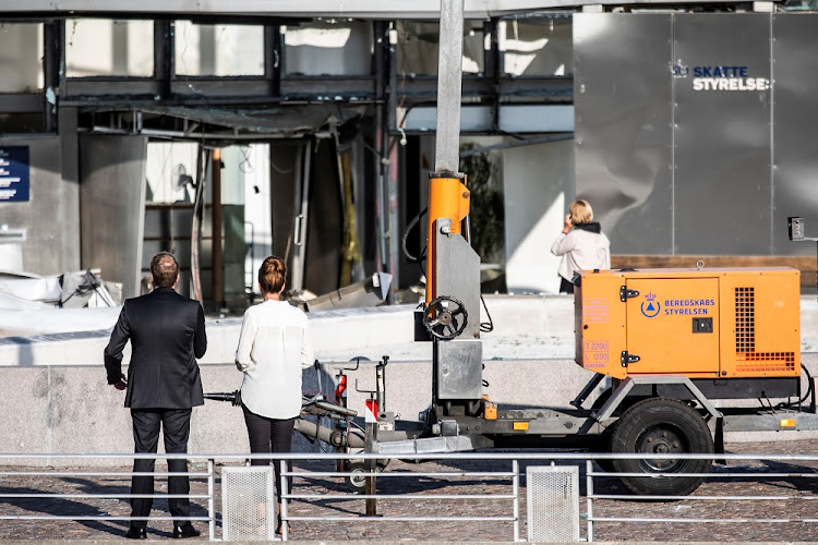 Director of the Danish Tax Agency Merete Agergaard and Danish Minister of Taxation Morten Boedskov stand outside the damaged Tax Board office building at Oesterbro, where an explosion occurred near Nordhavn Station, in Copenhagen, Denmark, August 7, 2019.