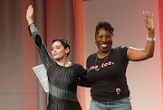 Founder of the #MeToo campaign Tarana Burke (R) with Rose McGowan during the opening session of the three-day Women's Convention at Cobo Center in Detroit, Michigan, U.S., October 27, 2017.