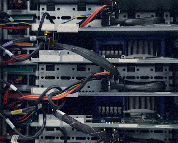 Extreme close up of a four servers and their network wires