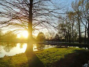 Photo: Sunset over a still lake at Eastwood Park in Dayton, Ohio.