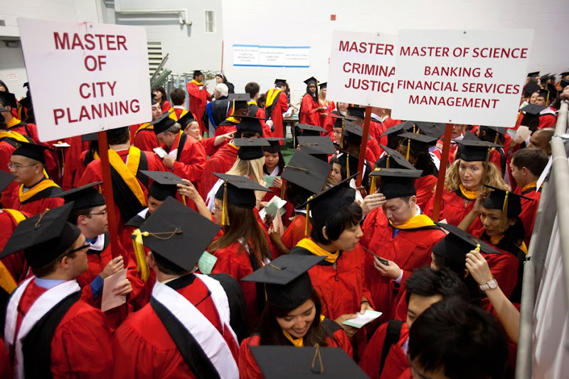 Photo: Masterful organization: There may have been a little confusion about where to line up at last Saturday's Boston University Metropolitan College convocation ceremony at the Track and Tennis Center. Photo by Winslow Martin