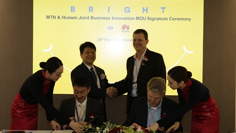 MTN and Huawei executives celebrate the signing of the business innovation agreement.