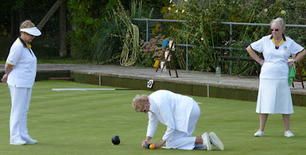 Photo: Ladies Singles Final- Eunice Hargreaves and Ann Armstrong watch Val Harvey, Marker on her knees.