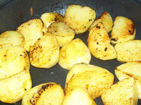 Wash the potatoes, peel them and cut them into quarters; brown them in the...