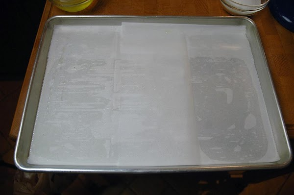 Grease a baking sheet and add a piece of parchment paper.