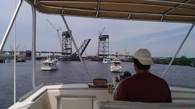 Photo: Waiting for a railroad and vehicle bridge to open moving up into the harbor in Norfolk. Very industrialized.