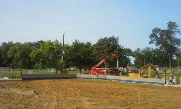 Photo: Fork Lifting Backstop Pole into position 08-06-2014