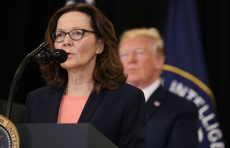 New CIA Director Gina Haspel speaks as President Donald Trump looks on after Haspel was sworn in at the headquarters of the Central Intelligence Agency in Langley, Virginia, US May 21, 2018.