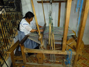 Photo: She demonstrates the foot powered loom