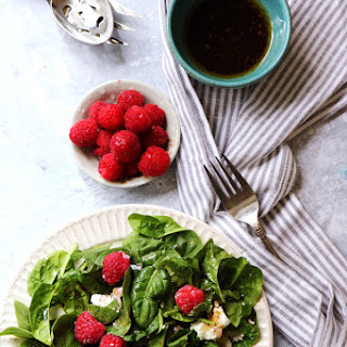 Simple Spinach Salad with Raspberries, Goat Cheese, and Balsamic Vinaigrette.