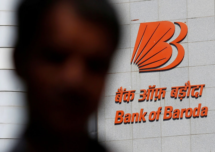 A man walks past the Bank of Baroda headquarters in Mumbai, India, May 3, 2016.