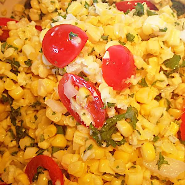 Fresh Corn Salad With Bright, Ripe Cherry Tomatoes.