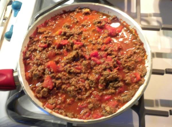 Brown hamburger. Add garlic, tomato sauce, tomatoes, oregano, salt & Pepper. Simmer 15 -...