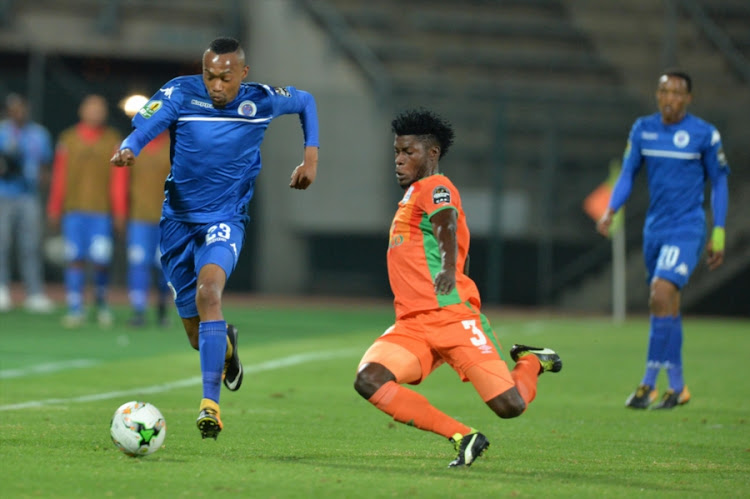 Thabo Mnyamane of SuperSport United (L) is tackled by Marcel Kalonda of Zesco United during the CAF Confederation Cup match  at Lucas Moripe Stadium on September 15, 2017 in Pretoria, South Africa.
