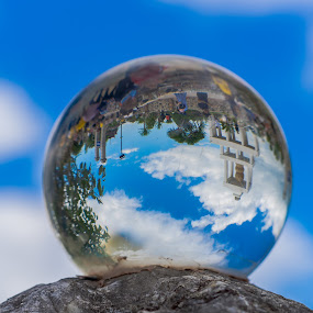 Reflections in a crystal ball. by John Greene - Artistic Objects Glass ( blue sky, crystal ball, still life, white clouds, reflections, john greene )