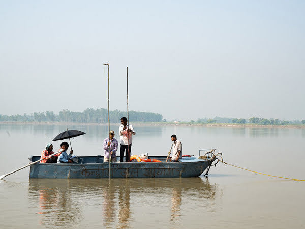 Boat crew measuring river depth in India