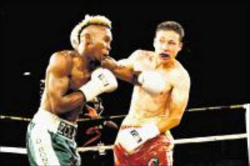 WIDE OPEN: Zolani Marali delivers a deadly left hook to Gamali Diaz's jaw during their IBO junior lightweight bout in Johannesburg recently. Marali will defend his title against Ji Hoon Kim on September 12. Pic: ANTONIO MUCHAVE. 03/04/2009. © Sowetan