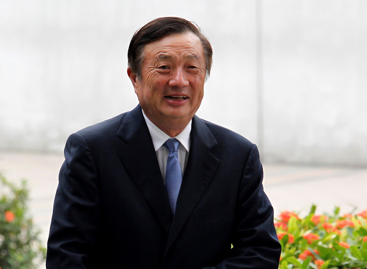 FILE PHOTO: Huawei CEO and founder Ren Zhengfei walks inside Huawei's headquarters in the southern Chinese city of Shenzhen, Guangdong province, China October 16, 2013.Picture: REUTERS / BOBBY YIP