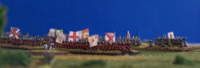 Photo: Sulla destra la milizia francese del Quebec fronteggia la linea di giubbe rosse inglesi.Miniature Baccus.