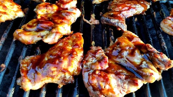 Once grill is hot. I spray the chicken on both sides with olive oil...