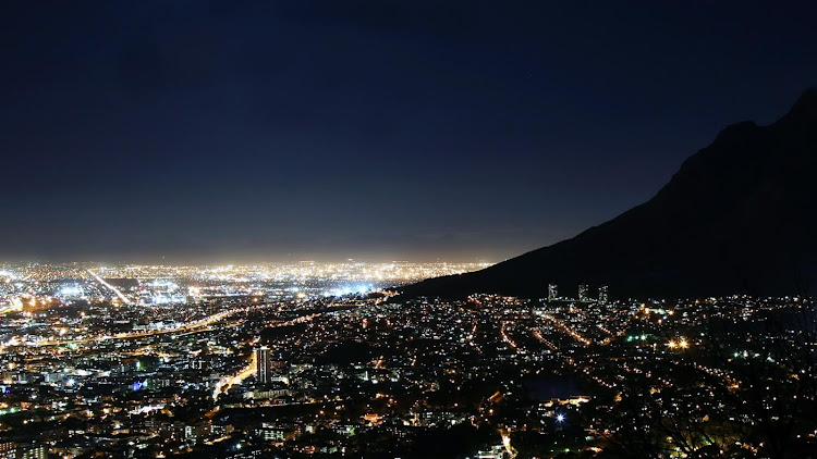 Before: Cape Town is filled with bright lights that usually mask the night sky above.