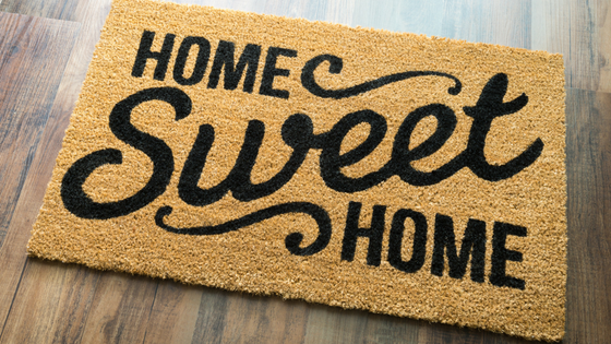 floor mat with the words Home Sweet Home in black lettering