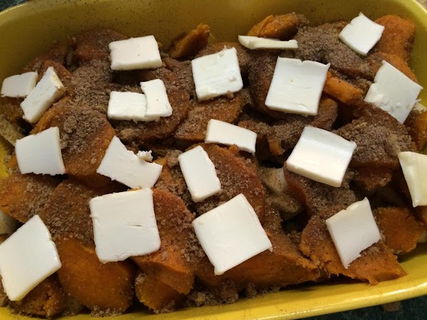 In a greased 1-½ qt baking dish, layer half of the sweet potatoes and...