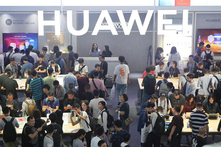 People visit the Huawei stand during day one of the 2019 Consumer Electronics Show Asia at Shanghai New International Expo Centre on June 11 2019 in Shanghai, China. Picture: VCG VIA GETTY IMAGES/CHINA NEWS SERVICE/ZHANG HENGWEI
