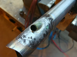 Photo: Brazing the internal brake cable routing.