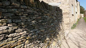 Thin stone dry stone wall repaired