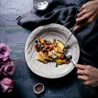 Millet And Corn Pancakes With Eggplant And Mozzarella Topping.