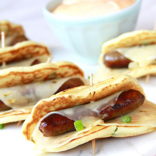 Spicy Green Onion Pigs in a Blanket with Sriracha Dipping Sauce.