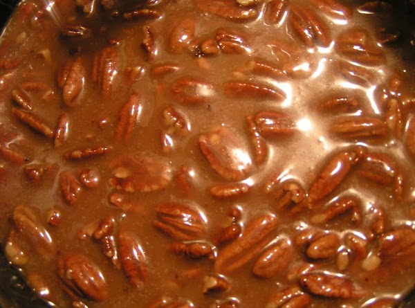 Add pecans and continue to cook, stirring constantly until it reaches 236 degrees (soft...