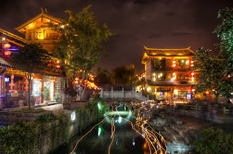 Photo: The Stone Bridge in the Old City  I just took this a few hours ago and wanted to share it first here to Google+.  A tiny stream flows through the middle of Lijiang -- it glides under countless little bridges and splits into countless little rivulets, each one twisting a different way through ancient neighborhoods.  As night falls, people begin lighting candles and setting them afloat inside tiny colored flowers. They flow downstream and people attach personal notes and moments to them. You can see on the right there that many people picked up different flower-candles to set them adrift.  I made a behind-the-scenes video here while shooting this. I haven't had a chance to edit/upload yet, but I will… maybe some good ideas about how I did this shot for you.  yes btw that was Tom on the cliff up there in the post I made just before this one…   see the full size version on SmugMug at http://stuckincustoms.smugmug.com/Portfolio-The-Best/your-favorites/10668747_AuyBk#1479241625_kcjQ4m4  #SICInDatabase