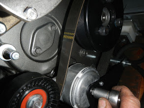 Photo: Belt tensioner tightened. www.electromaax.com