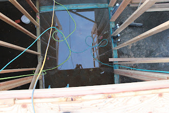Photo: Stairwell. Lots of water in this well!