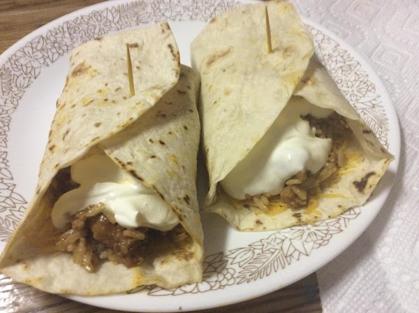 Heat tortillas in same skillet as chorizo.Serve with cheese & sour cream.