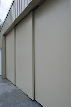 Photo: Three large sliding door panels created for the world's largest mint oil supplier.