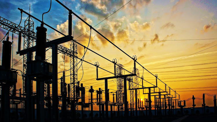 An electricity network at a transformer station at sunrise. Picture: ISTOCK