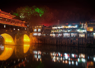 Photo: Beautiful Feng Huang at Night  After a few hours of shooting, I stopped at a small family-run restaurant that overlooked the river. I pulled out my sketch pad and started drawing the scene around me for a few hours while the nice mom inside brought me all kinds of mysterious hot foods, teas, and little cookies. It was a very peaceful and nice night...  from Trey Ratcliff at www.stuckincustoms.com
