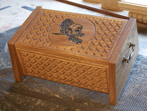 Photo: Solid oak box with Celtic knot engraving and art work. Dimensions approx' 340 x 200 x height 150mm.  Handcrafted wooden boxes from the workshop of Karl Peet (BespokeCraft)email: enquiry@BespokeCraft.com; web: www.BespokeCraft.com