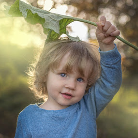under the leaf by Marek Kuzlik - Babies & Children Toddlers ( amazing, great, children, sun light, back light, leaf, portraits, light, fantastic )