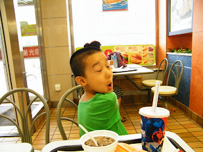 Photo: baby son, warrenzh 朱楚甲, ate breakfast in KFC on way returning to his mom's house after a night ported in his dad, benzrad 朱子卓's QRRS dorm, full of pc games and communications in trinity.