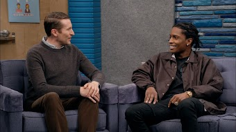 A$AP Rocky Wears a Black Button Up Jacket and Black Sneakers