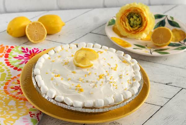 Triple Layer Lemon Meringue Pie Ready To Be Sliced.