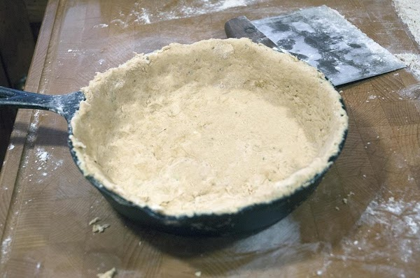 Carefully add the dough, and gently fit it to the skillet.